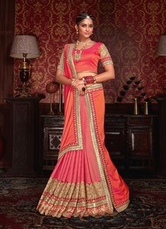 Buy latest saree from our different range of sarees online. Grab this faux chiffon orange traditional  saree