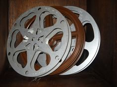 Spray paint old film reels for movie room