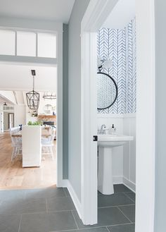 Blue and grey lake house mudroom. Slate floors.