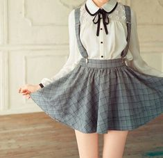 Cute school girl inspired outfit with the grey suspender skirt, black and white peter pan collar shirt with the black lined collar with the black ribbon.: