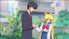 Usagi and Mamoru holding hands in the garden from Sailor Moon Crystal