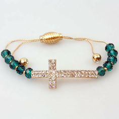 Accessory Accomplice Goldtone Crystal Encrusted Sideways Curved Cross Glass Cut Emerald Color Bead Adjustable Cord Bracelet -