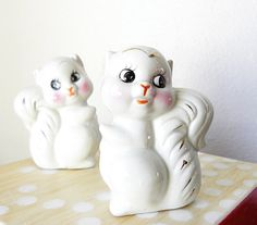 too cute vintage squirrels salt and pepper shakers . white with silver accents
