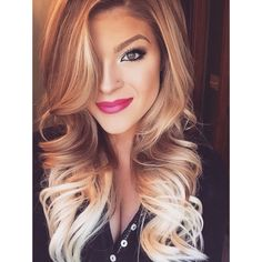 Blonde tips with light brown and highlights. <3