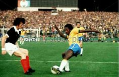 Brazil 0 Scotland 0 in 1974 in Frankfurt. Sandy Jardine stays tight on Paulo Cesar in Group 2 at the World Cup Finals.