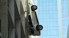 I know women are the butt of parking and driving jokes so this made me a chuckle. One to show the men I think.  Most importantly, he's ok. A driver in Austin, Texas has managed to escape from his vehicle after it was left dangling from the ninth floor of a car park.  The Austin Fire Department said he got out of the car through the sunroof following the botched parking attempt.  Police and firefighters were eventually able to lower the car to the ground safely.