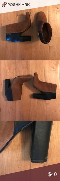 Black & Brown Joie Boots Brown suede with black leather back and heel. 3 inch heel. Smallest mark shown in picture of heel on left boot. Otherwise in great condition! By Joie. These are 7.5 but me and I am a 7. Joie Shoes Ankle Boots & Booties