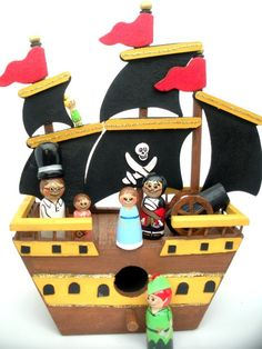 Peter Pan peg dolls and ship I got this ship from Riot Art and painted it for my pirate peg dolls Wood Peg Dolls, Clothespin Dolls, Wood Toys, Peter Pan, Clothes Pegs, Kegel, Homemade Toys, Tiny Dolls, Diy Toys