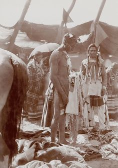 Assiniboine Indians of the Great Plains performing a sundance ceremony (1906)