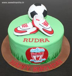 Liverpool football theme customized designer fondant cake with 3D football, shoes, Liverpool logo for football fan's birthday at Pune