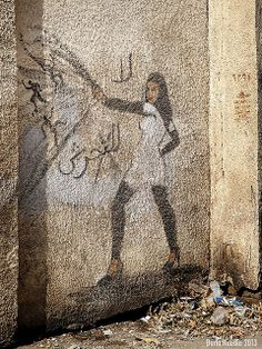 Amazing Graffiti from Cairo, Egypt of a woman embodying a goddess to fight street harassment.
