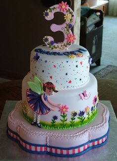 Fairy and flowers are gumpaste. grass stripes,and stems and leaves are painted. TFL #FairyCakes,Yummy!