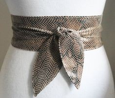 Beige Taupe snakeskin effect leather obi Tulip tie belt is made from real leather with a shiny finish. This beautiful Obi belt will accentuate your style be it casual or formal. Cinch in your waist and get instant curves and a flatter tummy. various ways to tie this sash belt.  Main color: Beige Taupe brown  Material: snakeskin effect real nappa leather Width 2 inches and 3 inches  Size- SMALL to fit waist sizes (in inches) 20 to 28 inches CLOTHING SIZE UK 4 to 10 US 0 to 6 total length 70…