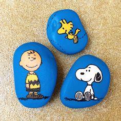 Peanut characters painted on stones