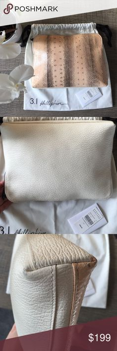 3.1 Phillip lim clutch/make up bag. 3.1 Phillip lim clutch/make up bag. Color is Blush/white. Used as a clutch. Signs of wear on the corners as seen, other wise all clean. 3.1 Phillip Lim Bags Clutches & Wristlets