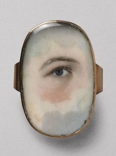 In de 18e eeuw was in Engeland een bijzondere portretvorm in de mode waarbij alleen het oog van een geliefde werd geportretteerd. Deze miniatuurschilderijtjes werden verwerkt in een ring, een hanger of ander kleinoden die altijd meegedragen konden worden en Lovers' Eyes werden genoemd.