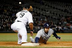 Jose Abreu Photos Photos - Kevin Kiermaier #39 of the Tampa Bay Rays is forced out at first base for the second out in a double play after Todd Frazier #21 of the Chicago White Sox (not pictured) caught a line drive, as Jose Abreu #79 takes the throw at U.S. Cellular Field on September 29, 2016 in Chicago, Illinois. - Tampa Bay Rays v Chicago White Sox