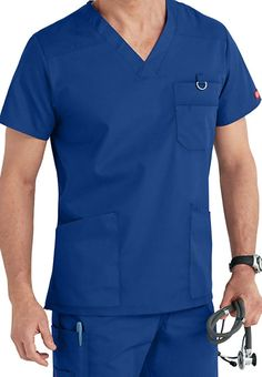 A PROVEN PERFORMER There's never any doubt you're choosing a winner when you suit up with this V-neck scrub top from Dickies. Lots of pockets provide the perfect storage to keep all your tools safe, including a double chest pocket and a stretchy interior pocket for those can't-lose keys and cards. Dickies EDS Signature V-Neck Men's Top Dickies EDS Signature Men's V-neck Scrub Tops V-neck Front and back yokes Hem slits 4 pockets: 2 front patch pockets, 1 inter... Medical Uniforms, Work Uniforms, Scrub Suit Design, Doctor Scrubs, Nurse Costume, Designer Suits For Men, Uniform Design, Medical Scrubs, Scrubs Uniform