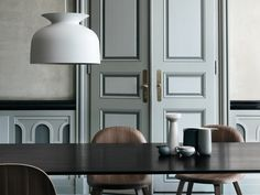 'Gubi Ronde' pendant available through Surrouding makes a bold statement in a large room.