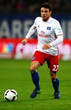 Nicolai Mueller of Hamburg runs with the ball during the Bundesliga match between Hamburger SV and FC Augsburg at Volksparkstadion on December 10, 2016 in Hamburg, Germany.