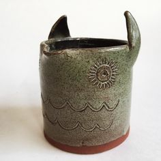 A personal favorite from my Etsy shop https://www.etsy.com/listing/465167685/mini-owl-pitcher-studio-pottery