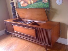 Im putting a 60's console like this under my flatscreen for a little new old yin yang look