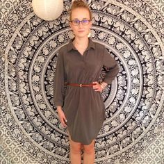 Long sleeve olive green shirt dress Long sleeve olive green shirt dress. Never worn. Very short so would fit a shorter person better. Is very cute worn with a belt around the waist as a shirt for someone taller. Faux silk material. Forever 21 Tops Tunics