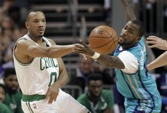Celtics guard Avery Bradley passed the ball past Hornets guard Michael Kidd-Gilchrist during the second half.