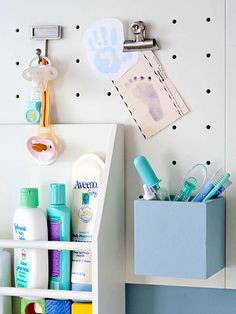 Baby Changing Station Pegboard - love this, but hate the idea of anchoring it to an apartment wall. In our someday home I guess.