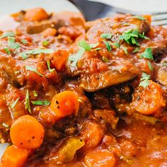 instant pot swiss steak with carrots and onions topped with parsley