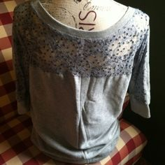 Victoria's Secret Plush & Lush Tunic Sweater XS New without tag Victoria's Secret Plush & Lush sweater,size xs.. Sweater is tunic length & 3/4 sleeve heathered gray with lace & sequence on back of shoulders.. Very,very comfy & really cute with leggings,or skinny jeans! Victoria's Secret Sweaters