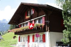 Swiss chalet inn, dark brown, red, and white
