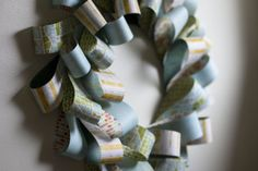 "Paper Wreath Tutorial at Scrapbuck.com.  Make a 12"" Wreath for less than $3.00.  Just Scrapbook Paper, Cardboard & Staples!"