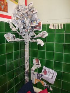 Newspaper tree. Book corner display to accompany Power of Reading sequence Into the Forest by Anthony Browne.