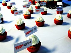 Red cupcakes with TEDx decorations