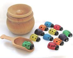 All of our toys are hand painted with non-toxic acrylic paint and sealed with a couple coats of gloss. This keeps the toys vibrant and completely sealed without having to worry about dye from the colour transferring all over your child if they happen to get the toys wet.  Explore and Learn Wooden Toys™ Ladybug Sort and Scoop Set includes: 1 Pot approx. 3 inches wide by 2 inches tall. 12 Ladybugs 1 inch size. ages 4+.  Comes with pot, lid, scoop and 12 bugs - 2 of each colour. Comes with…