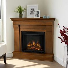 Don't have the full for a full-scale fireplace? Discover 15 Outstanding Corner Fireplace Ideas for A Cozier Ambiance in Electric Fireplace With Mantel, Corner Gas Fireplace, Brick Fireplace Makeover, Home Fireplace, Faux Fireplace, Modern Fireplace, Fireplace Design, Fireplace Mantels, Fireplace Ideas