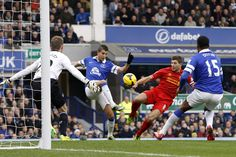 23 November 2013 Kevin Mirallas hooks the ball into the roof of the Liverpool net