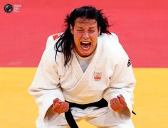 Netherlands' Edith Bosch celebrates after defeating South Korea's Hwang Ye-Sul in women's -70kg Bronze medal judo match at London 2012 Olympic Games. DARREN STAPLES/REUTERS