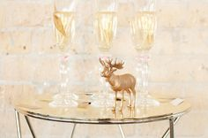 Glittery gold 'oh deer' decorations and details with DIY painted gold moose // Shot by @Je Lal Photography featured on #stylemepretty www.jelphoto.co.nz / Styled by @All The Frills #styled #wedding #shoot #inspiration