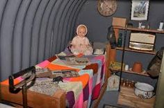 ww2 anderson shelter inside -           ANDERSON SHELTERS Anderson Shelter, 1940s Home, Ww2 Posters, Land Girls, British Home, The Blitz, Air Raid, Women In History, Holidays And Events