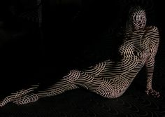 "To shoot these stunning nude portraits, Paris-based photographer Dani Olivier dressed his models with nothing but light, using their bodies as a canvas, combined with a series of geometric patterns to celebrate the beauty of the female form. ""Dani Olivier began working with light projections some eight years ago, and he's been refining the process ever since. He prefers to collaborate with dancers and other women who move to the beat of their own drums, whose bodies can ripple through…"