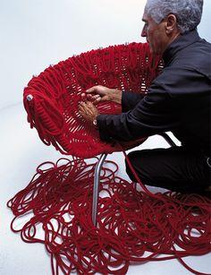 Vermelha chair,  special edition Campanas. Fernando and Humberto Campana knotting their chair.