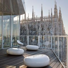 Driade è presente con: Pouf Koishi in fibra di vetro verniciato bianco by Naoto Fukasawa. Carla says: I ate at the Cube in London but it must have been incredible to look out onto the Duomo in Milan. Naoto Fukasawa, Modern Ottoman, Ottoman Design, Shed Roof, Roof Architecture, Roof Repair, Metal Roof, Design Firms, Pavilion