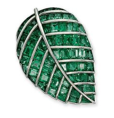 "AN EMERALD ""FEUILLE DE LILAS"" BROOCH, BY BOIVIN Set with calibré-cut emeralds between raised platinum veins, circa 1936, 4.5 cm long, with French assay marks for platinum and gold"