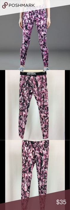 """Nike Leg-A-See Mish Mash Leggings Women's Nike Leg-A-See Mish Mash Leggings. Size small; 12"""" width, 8.5"""" rise, 28"""" inseam. 56% cotton, 33% polyester, 11% spandex. Mish mash pink, black, and white printed pattern. Fold-over waistband reading """"Just Do It."""" Black Nike logo on left upper thigh. Cute tights in very good used condition! Nike Pants Leggings"""