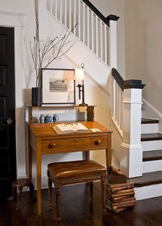 Paul placed a small antique desk and bench, handy for quick notes, next to the front-hall stairs.Remodeled Row House