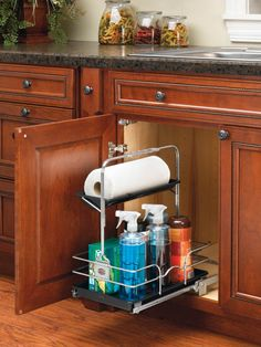 Rev-A-Shelf 544-10C-1 | Cleaning just got easier with the Undersink Caddy. Now you can store multiple cleaning items in one place and carry them with you with the removable caddy. The unique handle adjusts to accommodate plumbing fixtures and the reversible/ removable top tray is ideal for paper towel or sponge storage.