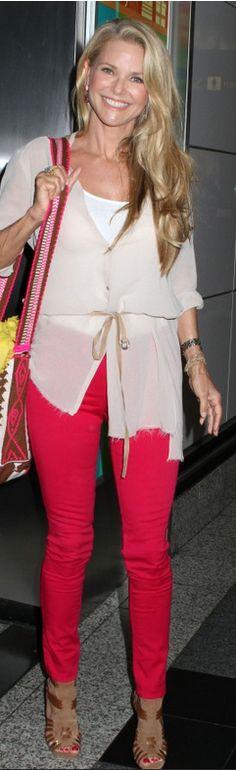 Christie Brinkley in hot pink skinny Rag & Bone jeans and a Helmut Lang nude top.