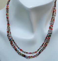 #multistrandseedbeads #necklace #bohemiannecklace, #womennecklace #multicoloredseedbeads #metal seedbeadsnecklace #stackednecklace #lanesamarieonEtsy
